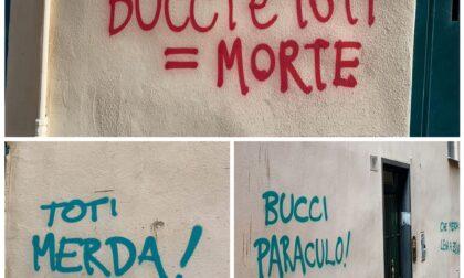 Insulti a Toti e Bucci sui muri di Genova
